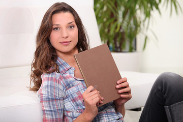Woman holding diary