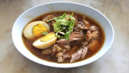 Pork leg soup with egg
