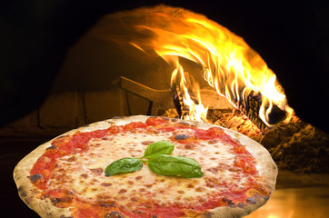 Pizza Margherita in a pizza oven