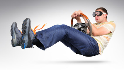 Funny driver in goggles with a wheel, auto concept