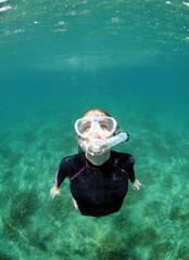 Woman snorkeling underwater in ocean