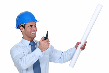Architect with radio receiver and plans
