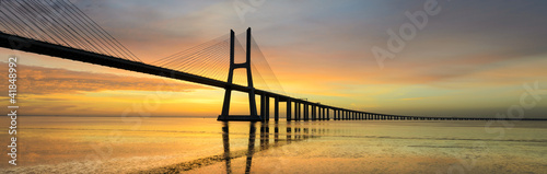 Leinwandbild Motiv Panorama image of the Vasco da Gama bridge in Lisbon