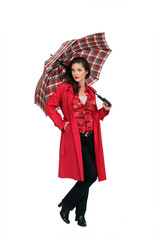 A fashionable woman holding an umbrella
