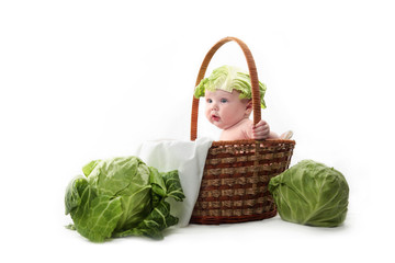 Baby in basket with cabbage