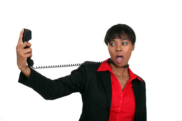 businesswoman trying to hang herself with the phone cable