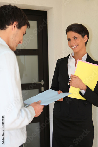 Smart woman giving contract to a man