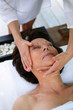Woman having her face massaged