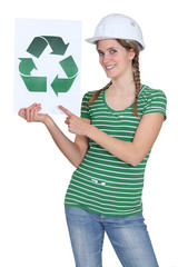 Woman with helmet and recycling poster