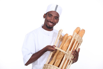 Young man baker smiling