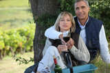 couple on a romantic picnic in a vineyard