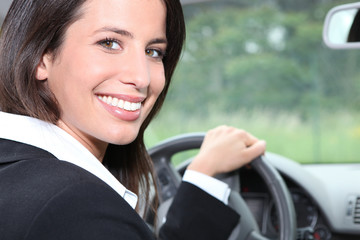 Salesperson driving a car