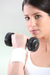 Closeup of a woman using a dumbbell