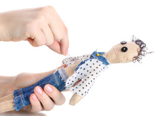 Voodoo doll boy in the hands of women isolated on white