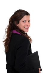 Brunette woman holding folder under arm