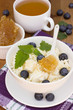 A healthy breakfast of cheese, berries and honey