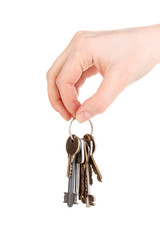 Bunch of keys in hand isolated on white