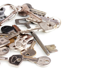 Lot of metal keys isolated on white