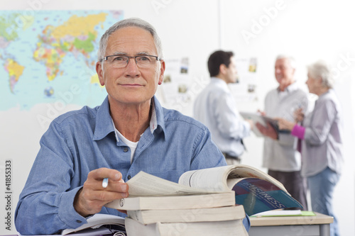 Adult student studying textbook in college evening class