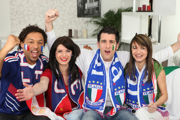 Group of friends supporting France and Italy