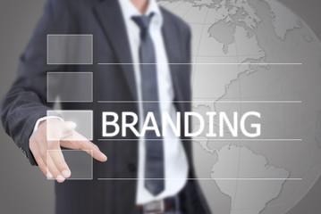 Businessman pushing Branding word on the whiteboard.