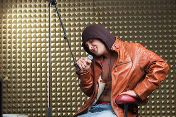 Singer sitting in recording studio