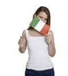 Attractive woman hides her face behind flag of Italy