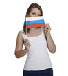 Attractive woman hides her face behind flag of Russia