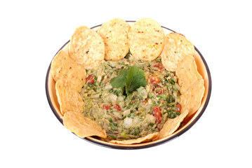 Guacamole dip with nachos on white