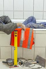 drunk tiler, worker sleeping in bath