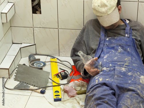 Drunk worker sleeping in the bath