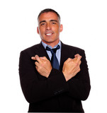 Adult latin man crossing arms and fingers poster