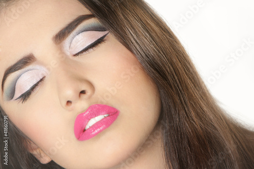 close up studio portrait of young beautiful woman with bright ma