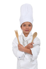 little girl dressed as cook