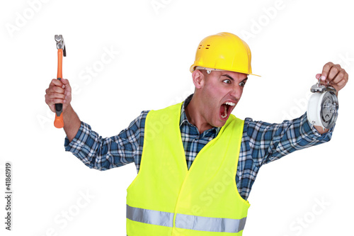Angry tradesman looking at the time