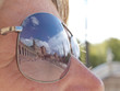 Close up of Plaza de Espana reflected in tourist's sunglasses, Seville, Spain