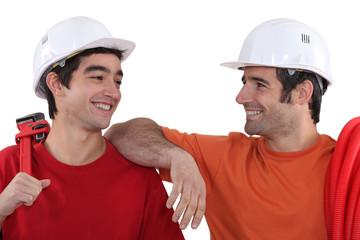Cheerful plumbers