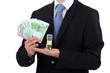 Man holding toy blocks and money