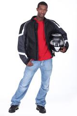 Biker stood holding helmet