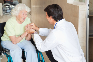 Doctor Comforting Happy Senior Woman