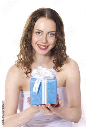 The beautiful girl smiling holds a gift