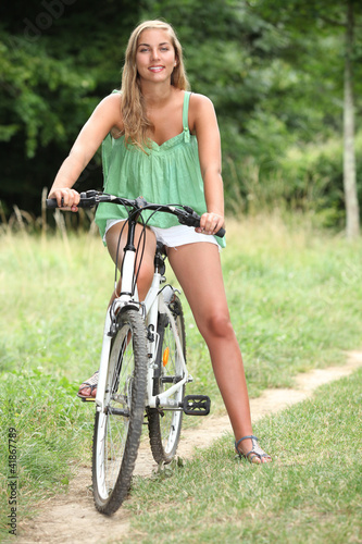 Young woman on a bike in the countryside