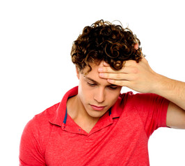 Stressed out guy with hand on his forehead