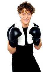 Boxer boy in sports outfit ready to punch you
