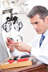 Optometrist Holding Measuring Eye Glasses