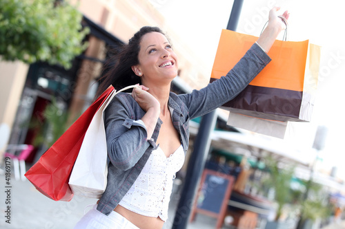 Woman shaking up bags
