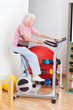 Senior Woman Exercising On Bike