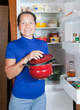 woman  with pan the fridge