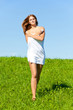Woman with towel on meadow