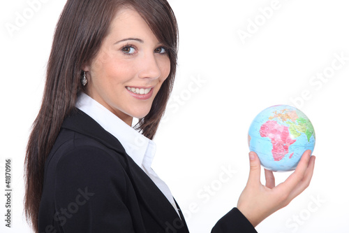 Young businesswoman with the world in her hands